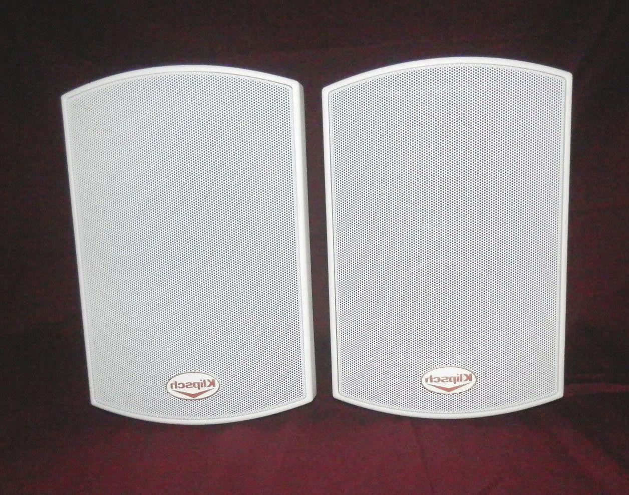 2 white speackers aw 400 indoor outdoor